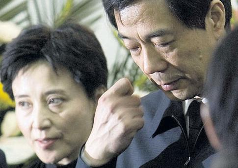 ONCE A CONTENDER: Bo Xilai and his wife Gu Kailai
