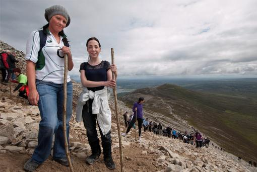 The annual Reek Sunday pilgrimage, 29 July, on Ireland's holy mountain Croagh Patrick, near Westport, Co Mayo. Pictured is Emma Rouse and Aisling McCrea from Strabane , Co. Tyrone on their way the mountain. Pic: Michael Mc Laughlin