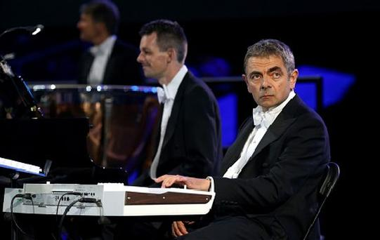 British actor Rowan Atkinson in his role as Mr Bean takes part in the Opening Ceremony of the London 2012 Olympic Games. Photo: Getty Images