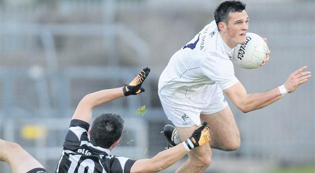 Kildare's Eoin Doyle sees off the challenge of Sligo's Johnny Davey during their victory in Roscommon on Saturday