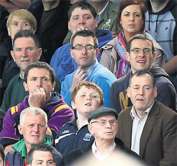 Peter Darragh Quinn, wearing glasses and a light blue jumper, attending his second GAA match in two days yesterday at Brewster Park on the outskirts of Enniskillen, Co Fermanagh.