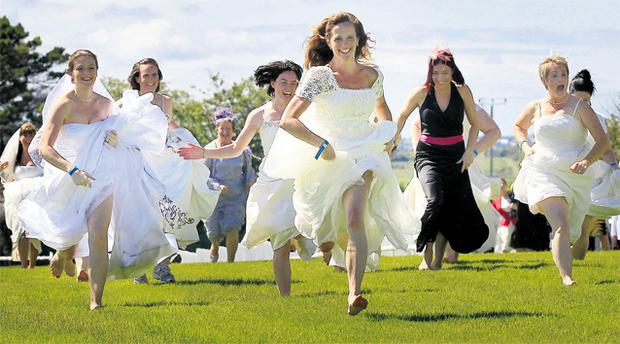 Caoilinn de Bairead from Galway leads the way to the finish line during the brides' race in aid of Special Olympics Connacht at the Galway Races yesterday