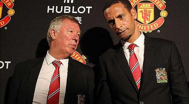 Charged: Rio Ferdinand (right) and Manchester United manager pose for the cameras during the club's tour of China. Photo: PA