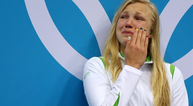 Ruta Meilutyte of Lithuania reacts as she receives her gold medal