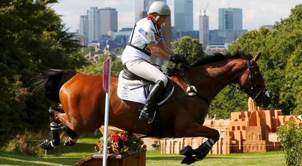 Zara Phillips rides High Kingdom as she competes in the Eventing Cross Country equestrian event