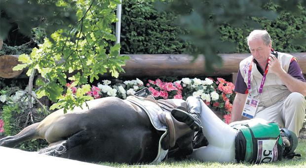 Ireland's Camilla Speirs lays near her horse Portersize Just a Jiff after she fell in the Eventing Cross Country event. Photo: Reuters