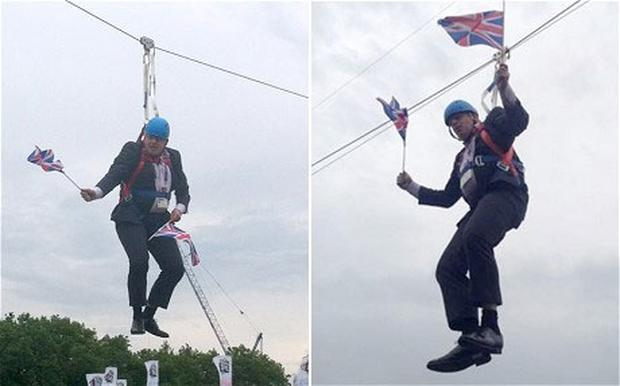 London Mayor Boris Johnson gets stuck whist trying out a zip wire in Victoria Park, London