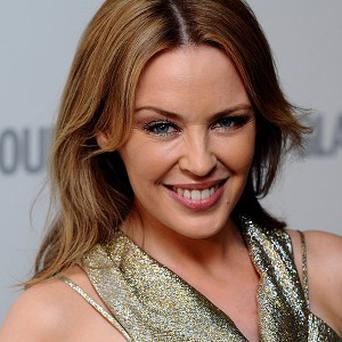 Kylie Minogue could finally get her planned on-stage reunion with Jason Donovan in December