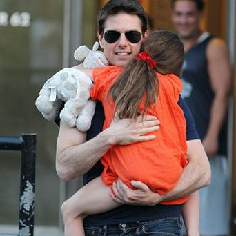 Tom Cruise and daughter Suri: he told Ryan Seacrest they have celebrated her birthday in advance together