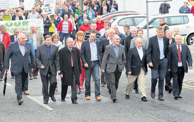 Senior GAA figures march in support of Sean Quinn at Ballyconnell, Co Cavan, last weekend. Inset: yesterday's GAA statement and memo from Fine Gael.
