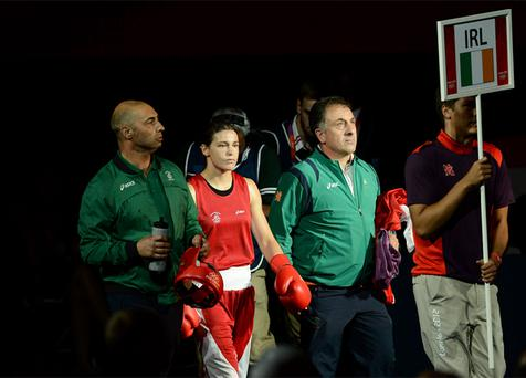 Katie Taylor, accompanied by her coach and father Pete Taylor and technical coach Zaur Antia, enters the arena before her bout against Natasha Jonas. Photo: Sportsfile