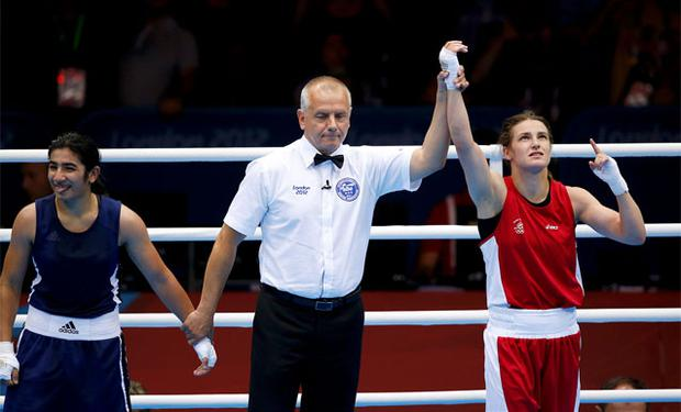 Katie Taylor is declared the winner over Tajikistan's Mavzuna Chorieva