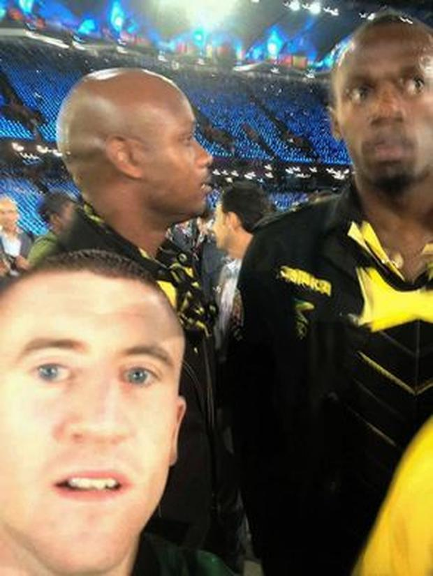Paddy Barnes with Usain Bolt in background