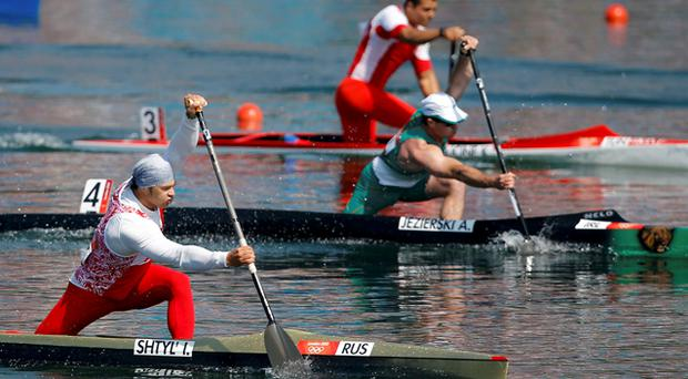 Day 14: Russia's Ivan Shtyl' (front), Ireland's Andrzej Jezierski (C) and Tunisia's Khaled Houcine compete in the men's canoe single (C1) 200m semifinal