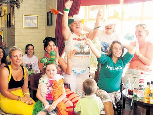 John Joe Nevin's mother Winnie (centre) celebrates her son's win with family and friends (also pictured below), at The Covert Bar, just outside Mullingar, Co Westmeath