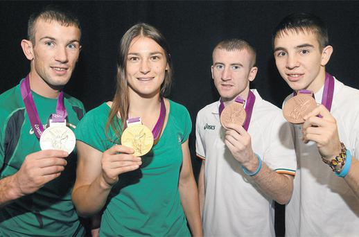 Ireland's boxing medallists John Joe Nevin, Katie Taylor, Paddy Barnes and Michael Conlan show off their valuable London souvenirs yesterday