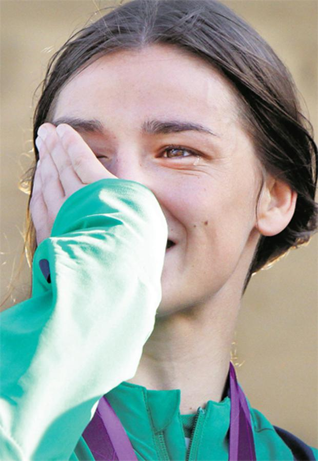 Katie Taylor wipes away tears of happiness at her homecoming party in Bray yesterday