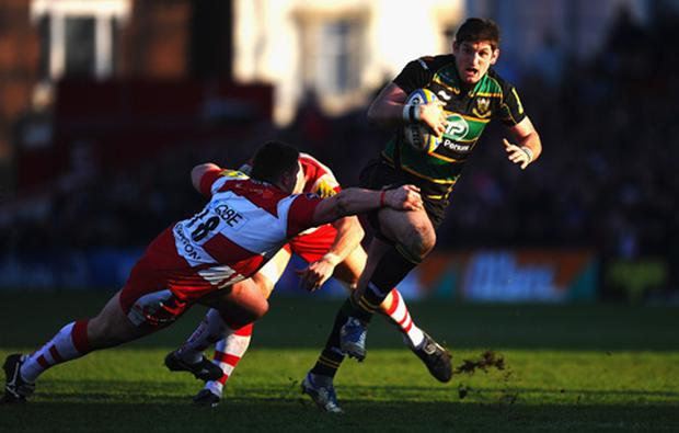 James Downey of Northampton is tackled by Shaun Knight of Gloucester during the Aviva Premiership match between Goucester and Northampton Saints at Kingsholm Stadium on February 11, 2012 in Gloucester, England.