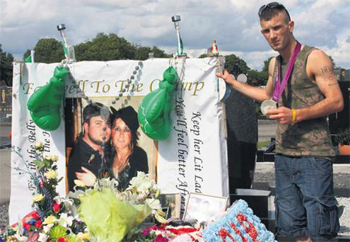 Silver medallist John Joe Nevin at the grave of his cousin David Nevin, who died of a heart attack in February