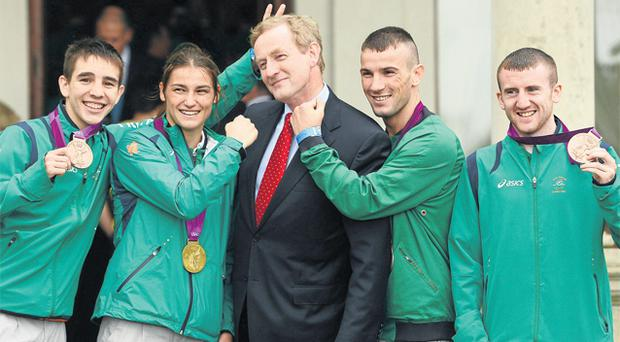 Katie Taylor joined fellow boxers Michael Conlan, John Joe Nevin, and Paddy Barnes to pose with Enda Kenny