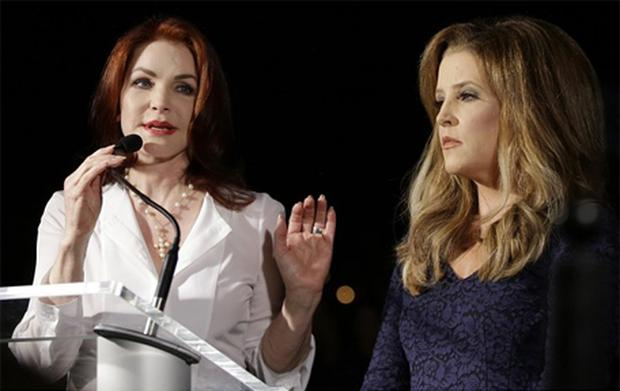 Priscilla Presley, left, and Lisa Marie Presley speak to fans gathered at a candlelight vigil at Graceland, Elvis Presley's Memphis home on the 15th August 2012. Fans from around the world are at Graceland to commemorate the 35th anniversary of Elvis Presley's death. Photo: AP