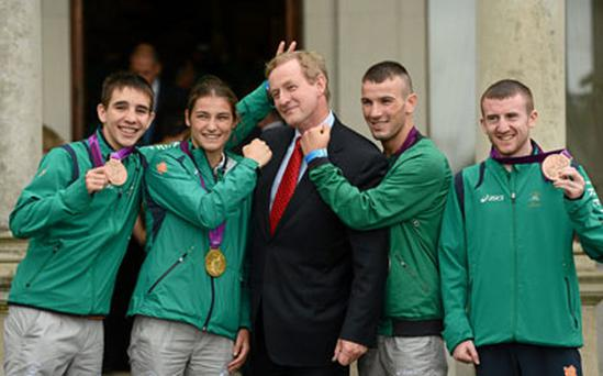 Team Ireland boxing medallists, from left, Michael Conlan , bronze, Katie Taylor, gold, John Joe Nevin, silver, and Paddy Barnes, bronze, with An Taoiseach Enda Kenny