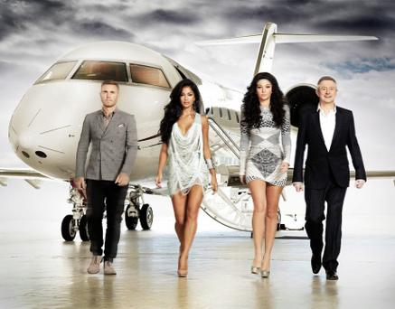 X Factor...Embargoed to 0001 Wednesday August 15: Undated handout photo issued by ITV of X Factor judges (left to right) Gary Barlow, Nicole Scherzinger, Tulisa Contostavlos and Louis Walsh in front of the Learjet in which they will be seen travelling to auditions for the new series of the ITV1 show. PRESS ASSOCIATION Photo. Issue date: Wednesday August 15, 2012. The team return to screens on Saturday night with a 75-minute edition of the programme which ITV bosses hope will bring a ratings bonanza, as it is coupled with a new series of Red Or Black?. See PA story SHOWBIZ XFactor. Photo credit should read: Ken McKay/ITV/PA Wire NOTE TO EDITORS: This handout photo may only be used for editorial reporting purposes for the contemporaneous illustration of events, things or the people in the image or facts mentioned in the caption. Reuse of the picture may require further permission from the copyright holder....E