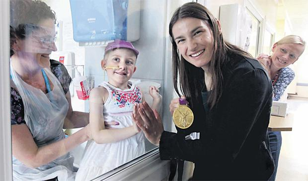 At Our Lady's Children's Hospital Katie Taylor meets five-year-old Ella Sherlock, who is being treated in isolation, and her mother Dawn, from Knocklyon in south Dublin