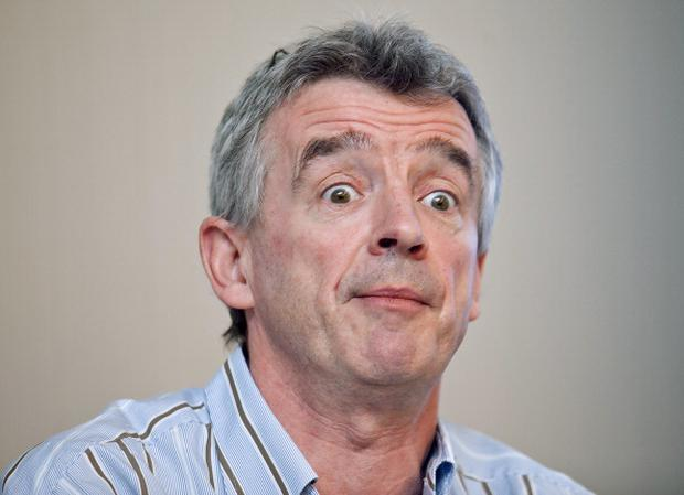 CEO of Irish low-cost airline Ryanair Michael O'Leary grimaces as he speaks during a press conference, on March 29, 2012 in Brussels. AFP PHOTO/BELGA/ OLIVIER VIN -Belgium Out- (Photo credit should read OLIVIER VIN/AFP/Getty Images)