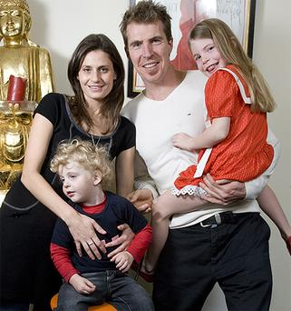 Jim Stynes with his wife Sam and children Matisse and Tiernan