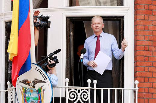 WikiLeaks founder Julian Assange gives a thumbs up sign after speaking to the media outside the Ecuador embassy in west London