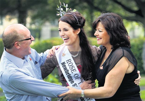 Newly crowned Rose of Tralee 2012 Nicola McEvoy in the Rose Garden of Tralee town park yesterday, with her parents Michael and Mary