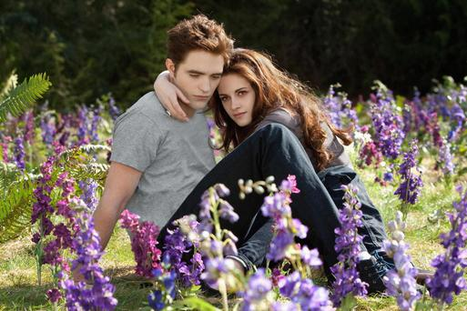 This film image released by Summit Entertainment shows Robert Pattinson and Kristen Stewart in a scene from