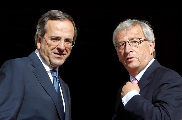 Greece's Prime Minister Antonis Samaras (L) welcomes Luxembourg's Prime Minister and Eurogroup chairman Jean-Claude Juncker during their meeting in Athens