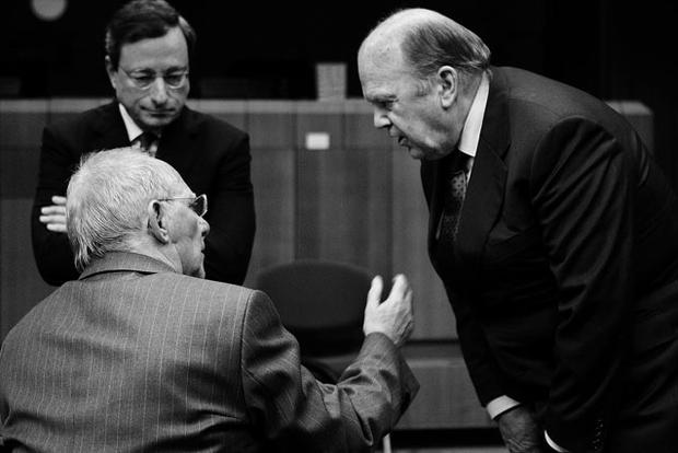HEAVY TALK: Finance Minister Michael Noonan, right, discusses the eurozone crisis with his German counterpart Wolfgang Schauble, front in picture, as Mario Draghi, head of the ECB, looks on