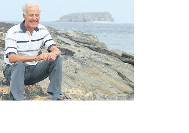 Relief: Fr Eugene Boland at Pollan Strand in Ballyliffin.