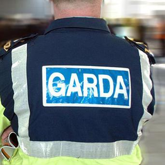 Armed Gardai arrested a man wearing a balaclava near a Cork post office after locals reported suspicious activity