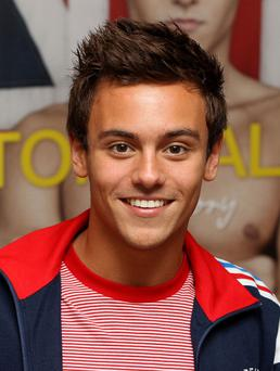 LONDON, ENGLAND - AUGUST 16: Tom Daley signs copies of his book 'Tom Daley 'My Story' at Waterstones on August 16, 2012 in London, England. (Photo by Danny Martindale/Getty Images)