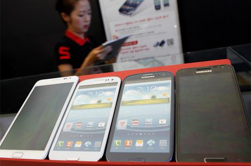 Samsung Electronics' Galaxy smartphones are displayed at a store in Seoul