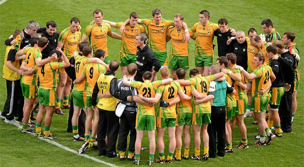 Donegal manager Jim McGuinness speaks to his players before the game against Cork on Sunday