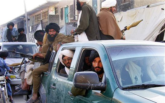 Taliban militants pictured in Musa Qala in 2007. Photo: Getty Images