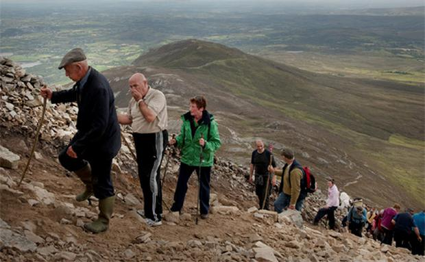 The annual Reek Sunday pilgrimage, 29 July, on Ireland's holy mountain Croagh Patrick, near Westport, Co Mayo. Pilgrims make their way up and down the rugged slopes of the mountain.