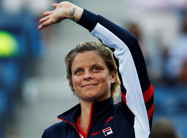 Kim Clijsters waves to the gallery after her loss to Laura Robson
