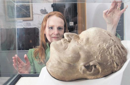 Irish Independent columnist Martina Devlin with the James Joyce death mask at the Joyce Tower, in Sandycove, Dublin