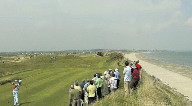 Rory McIlroy, back in his amateur days, watches his tee-shot on the 15th hole at Portmarnock. The club is considering changing its