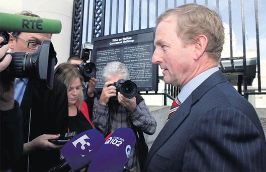 Enda Kenny arrives for the cabinet meeting at Government Buildings yesterday
