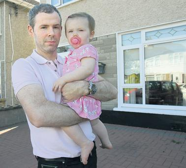 AT HOME: Keith McAuley and his one-year-old daughter Ava. Keith and his wife Sinead were refused a mortgage by AIB