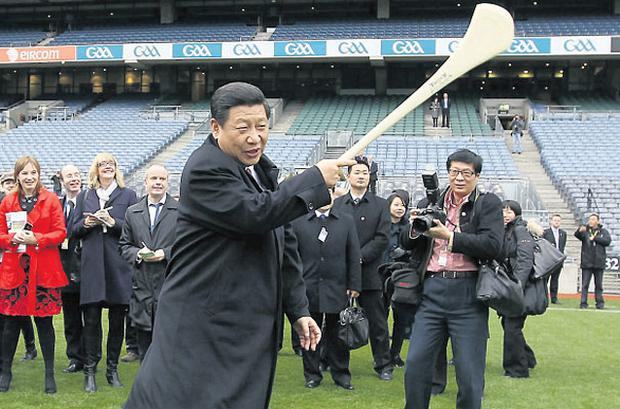 China's vice-president Xi Jinping, who has not been seen in public for nine days, tries out hurling at Croke Park during his trip to Ireland in February
