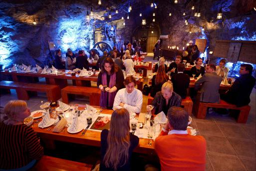 Customers eat their dinner at Muru Pop Down restaurant at Tytyri mine in Lohja, September 10, 2012. Finns this week opened the ultimate underground restaurant with a four-course menu including escargot flambeed in Pernod. Popular Helsinki restaurant Muru set up a temporary eatery some 80 metres below ground in a limestone mine in the southern Finnish town of Lohja. Inspired by