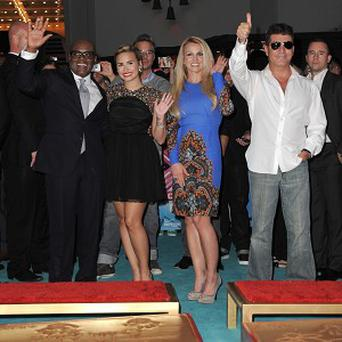 LA Reid, Demi Lovato, Britney Spears and Simon Cowell make up the judging panel on US X Factor